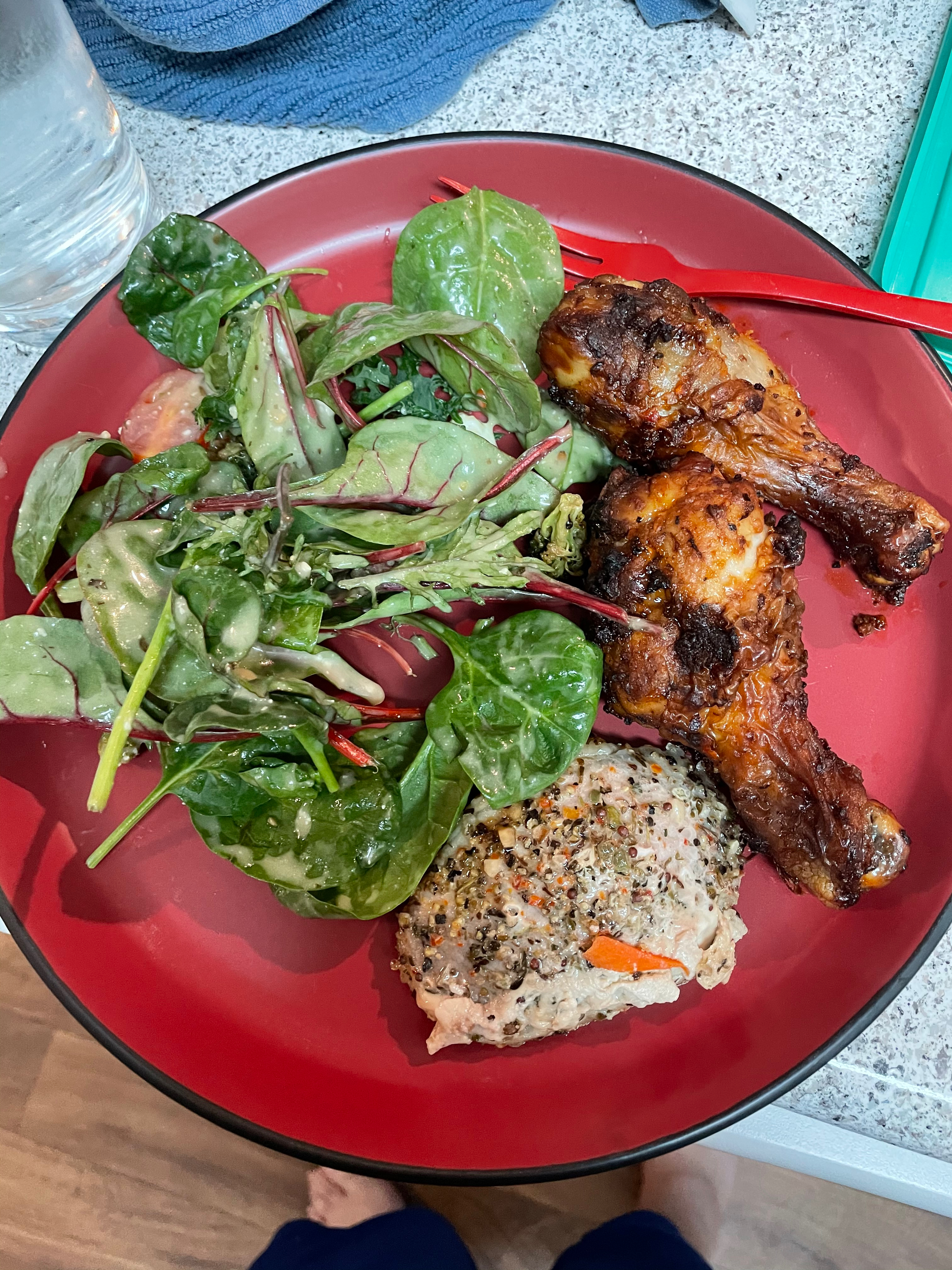 Chicken legs, pork and left over salad.