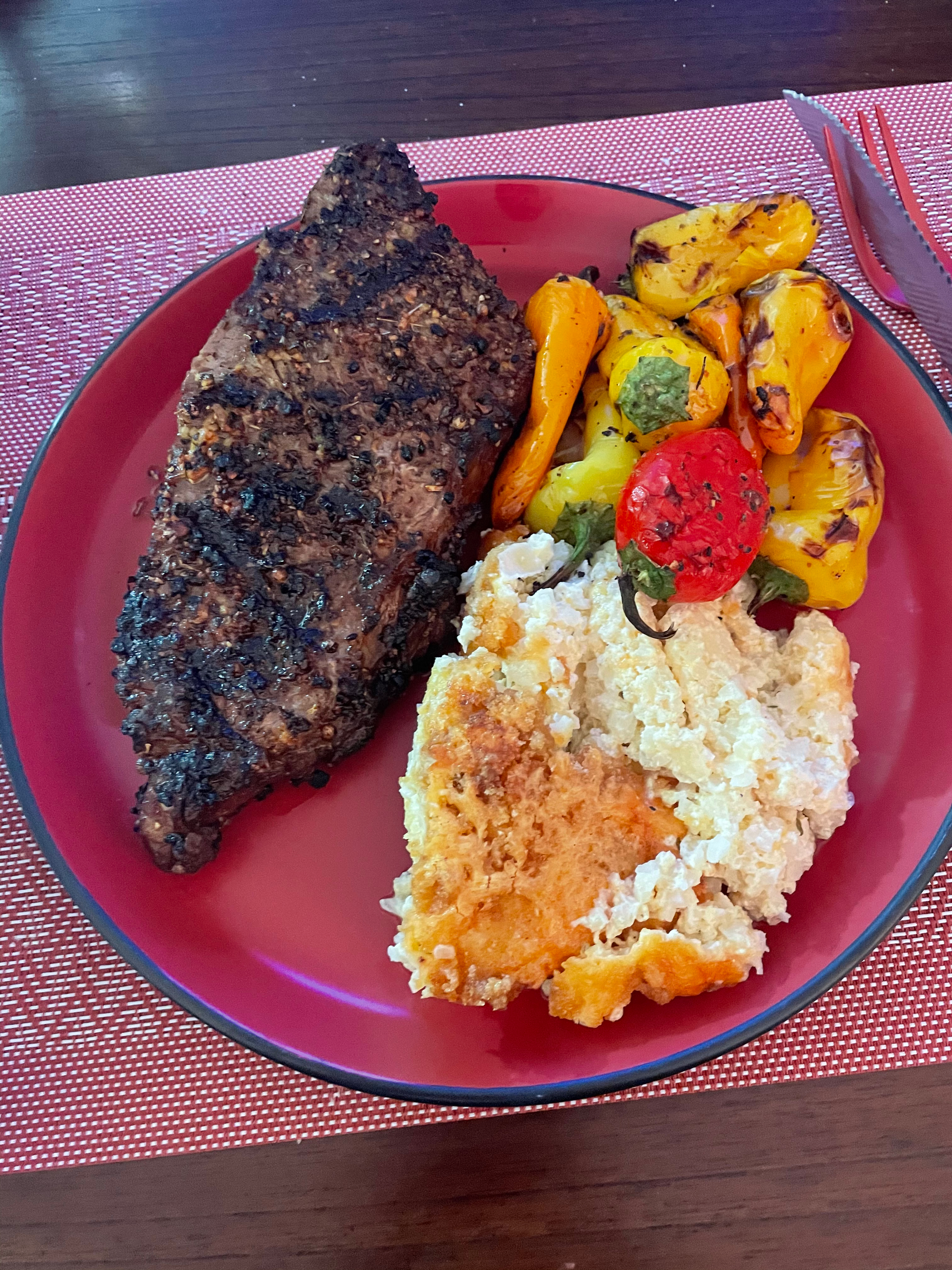 Steak with cauliflower casserole and peppers.